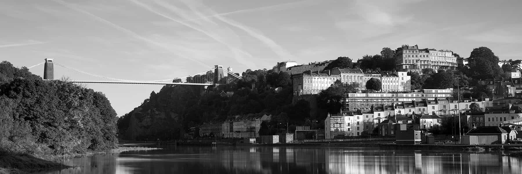 Clifton suspension bridge in black and white with views over the city and River Avon