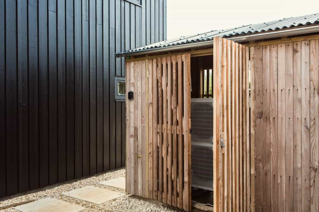 Passive house or passivhaus barn conversion with Douglas fir cladding and outdoor storage shed