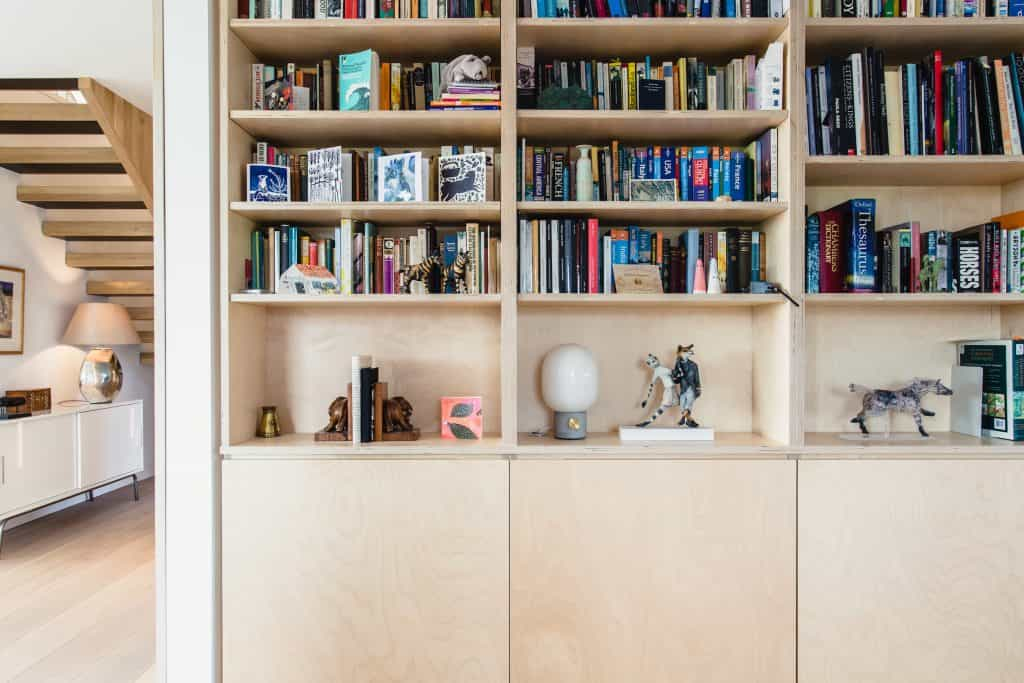 Passive house or passivhaus residence with bespoke joinery book case with ornaments