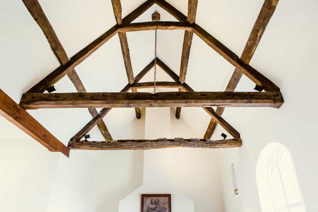 traditional timber frame exposed beams in hotels with large arch window