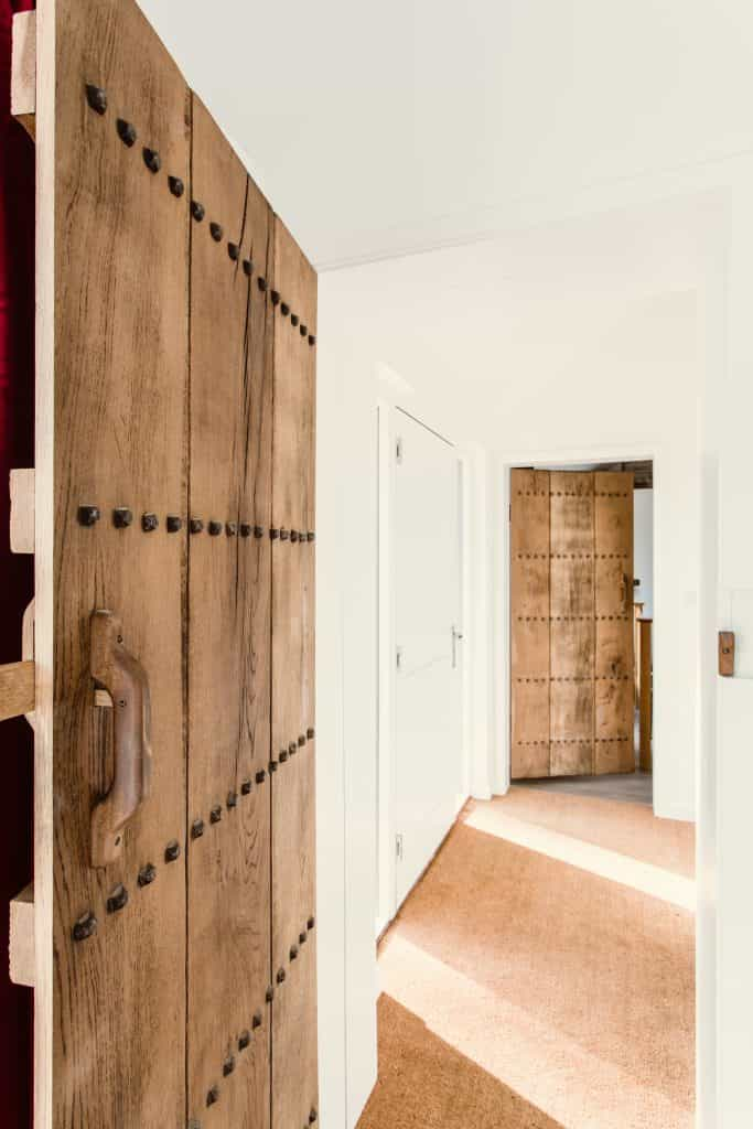 close up of Traditional and bespoke oak door in passivhaus or passive house hallway