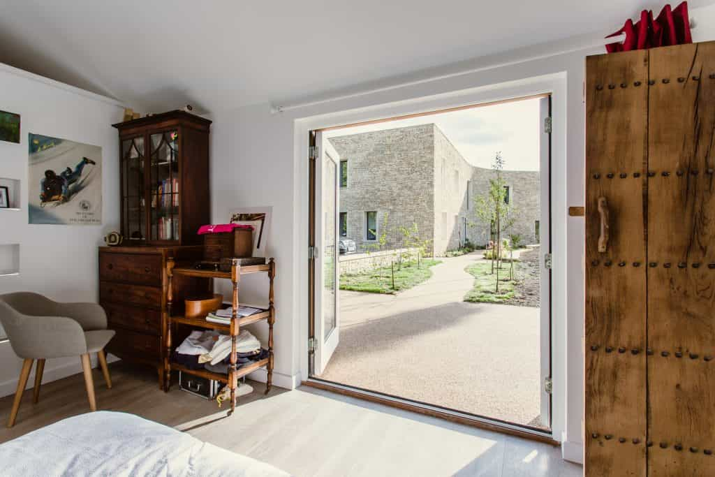 interior view of large passive house passivhaus cotswold stone building through glass double doors