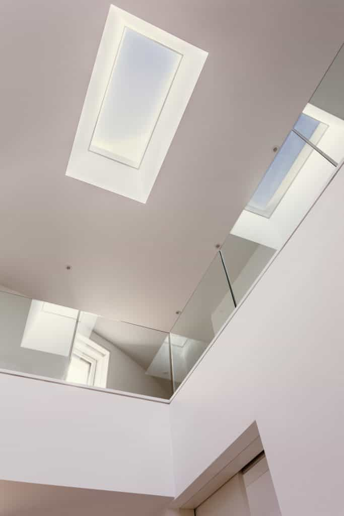 Passive house or passivhaus residence with glass open landing and hallway with skylight