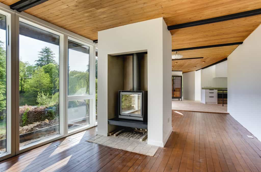 empty large residence with open log burner and large glass windows