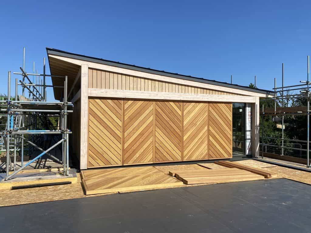 Passivhaus and Passivehouse under construction with decorative cladding