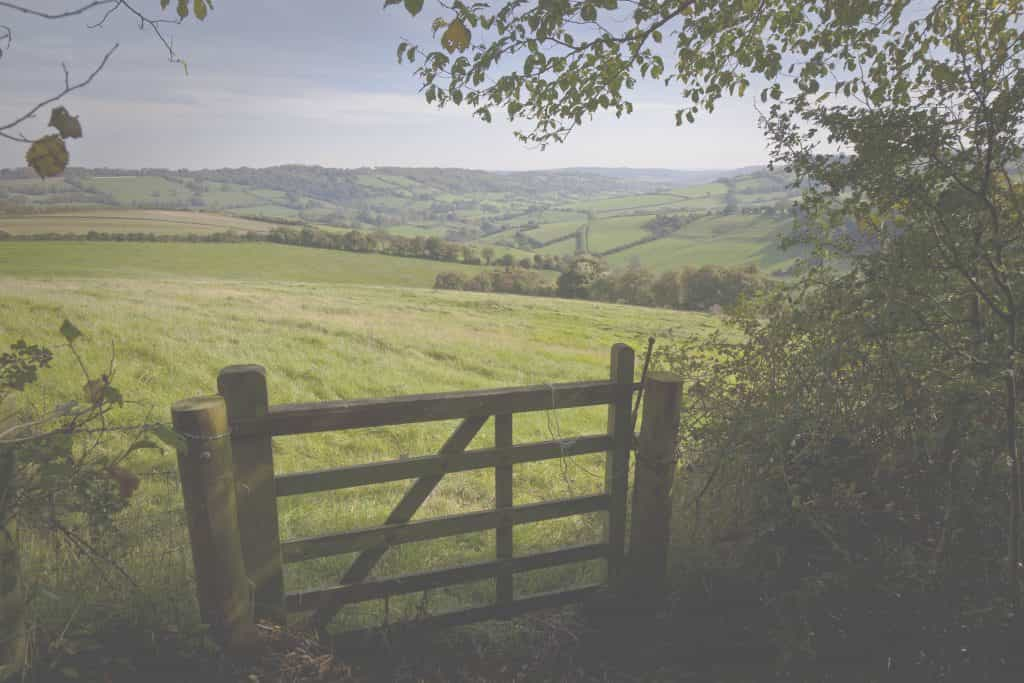 view from property overlooking rolling hills and countryside with wooden gate