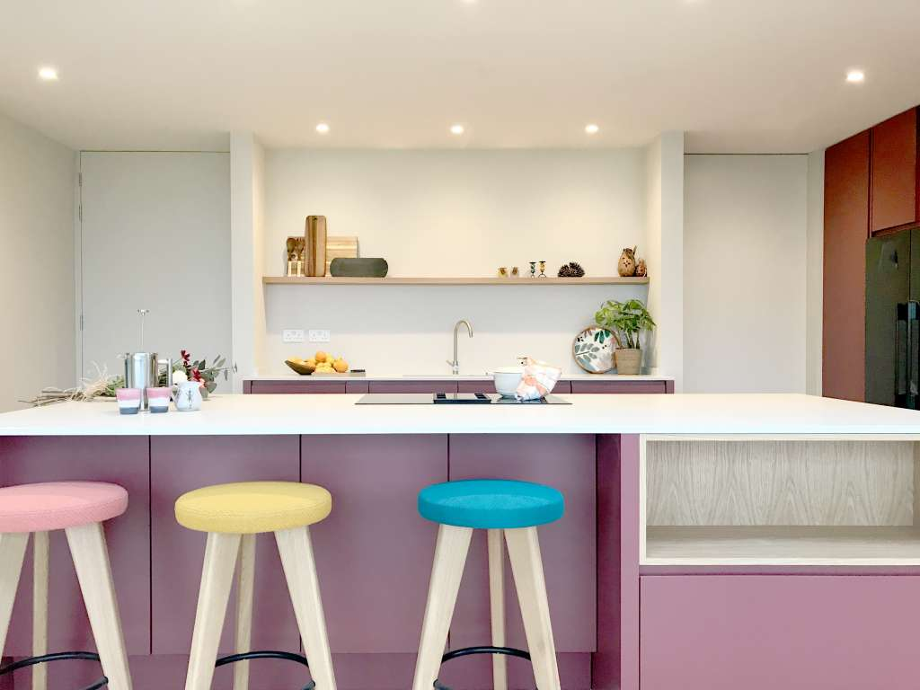 Luxury dark pink kitchen with James Burleigh stools and interior decor inspiration