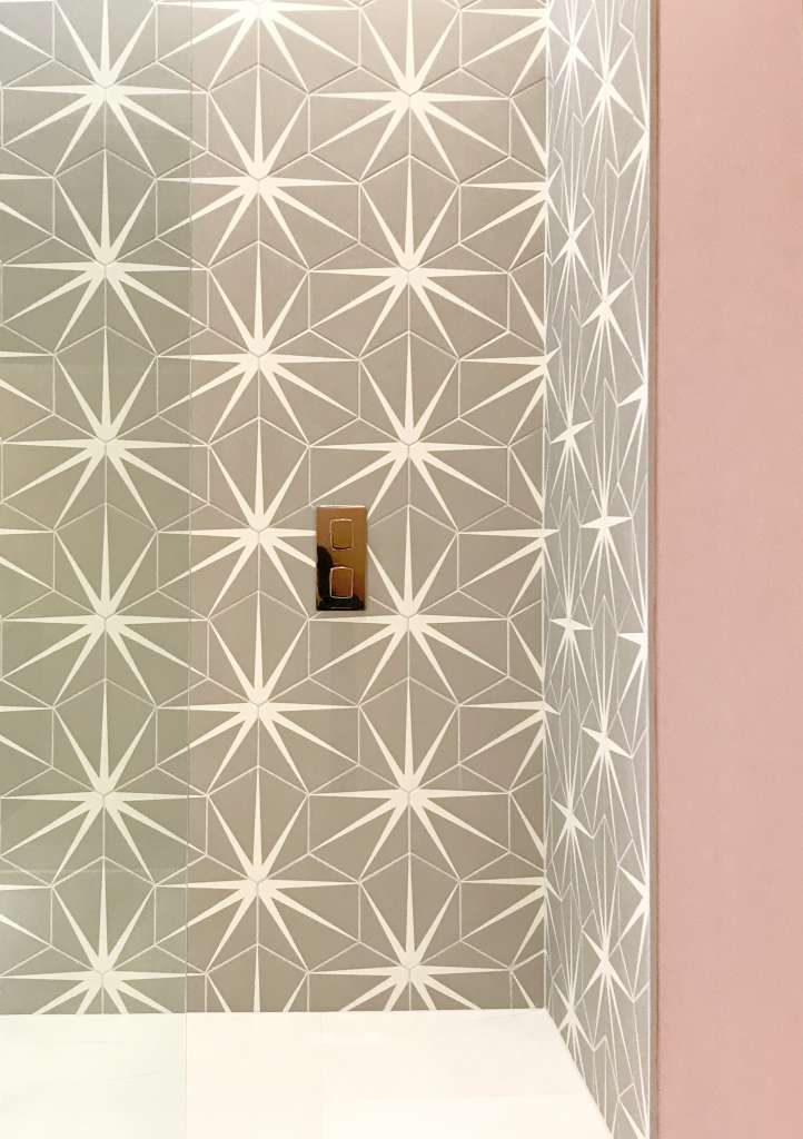 Shower with pink tiles and patterned star tiles