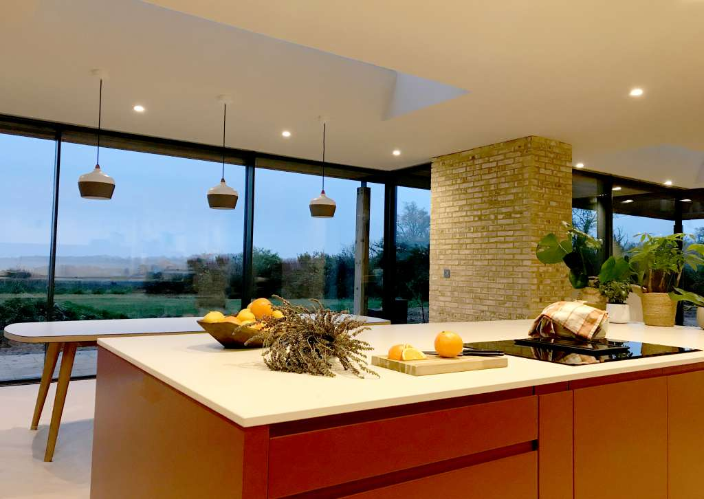Luxury kitchen and dining room with lavender, freshly cut oranges and International brickwork