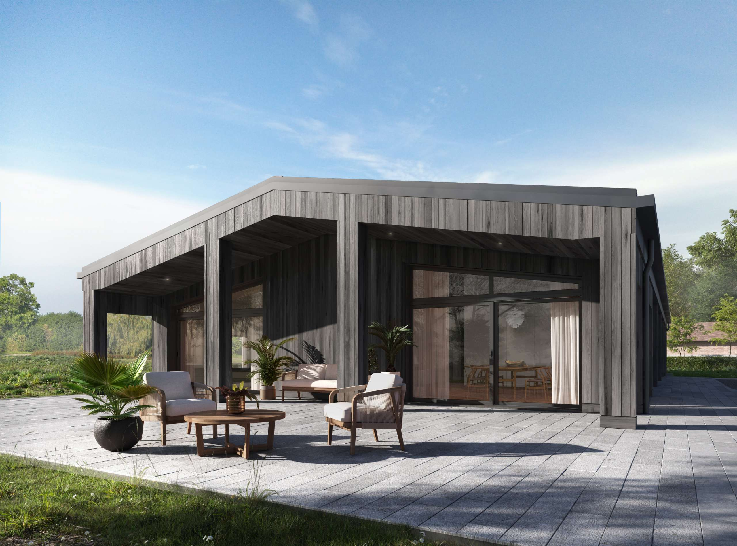 Passive House barn conversion with timber cladding and outdoor patio dining