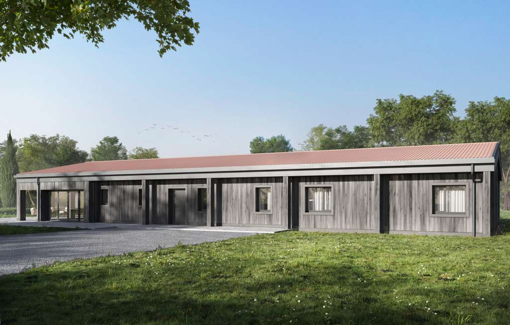 Passive House barn conversion with timber cladding and red roof tiles