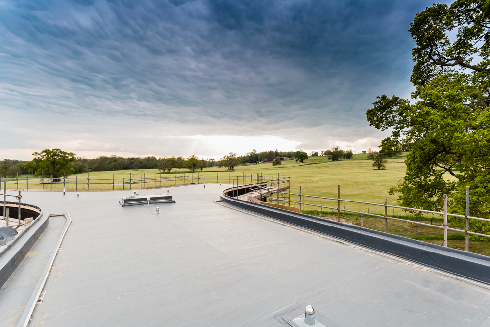 Passive House roof lining with view across landscape and sunset