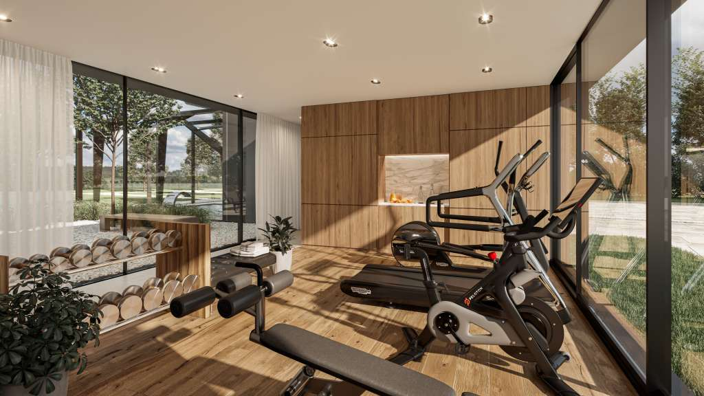 Luxury home gym indoor weights and peloton bike with glass doors and wooden joinery