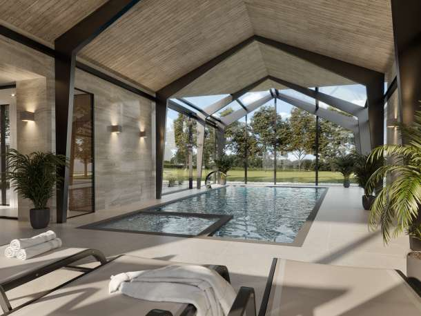 Luxury indoor swimming pool with views over landscape and indoor planting